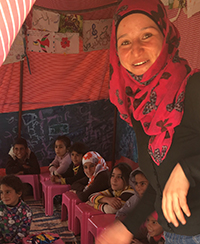 Jawaher, a former law student, holds classes in a tent for children in the desert of Jordan.