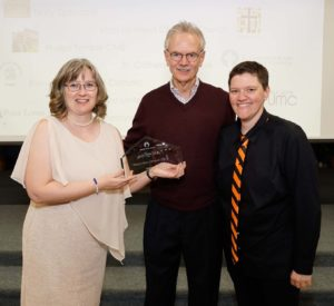 Pictured accepting the award are Pastor Rebecca Littlejohn, Chair of the Elders Michael Kinnamon, and Outreach Chair Julie Germain